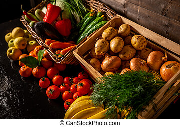 Fresh vegetables in a wooden box on a wooden background. Fruits and vegetables market