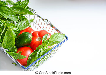 Fresh Vegetables in shopping cart or basket isolated on white background