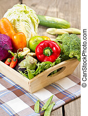 Fresh vegetables in wood tray