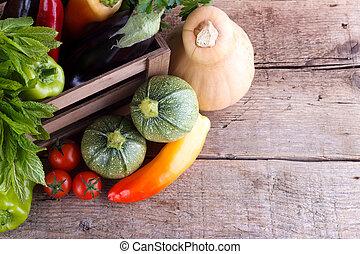 Fresh vegetables in wooden crate