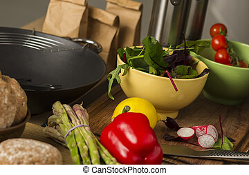 Fresh vegetables laid out on a kitchen counter