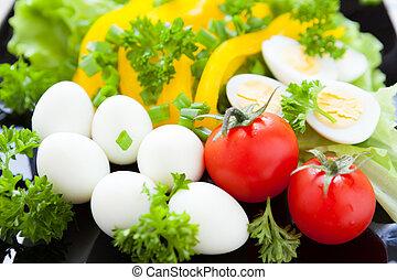 Fresh vegetables on a dish and quail eggs
