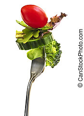 Fresh vegetables on a fork