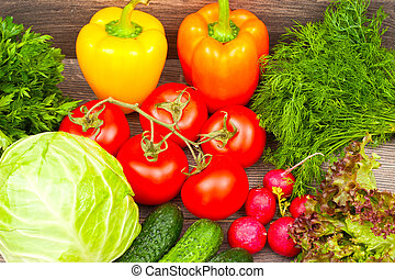 fresh vegetables on a wooden background