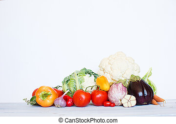 Fresh vegetables on a wooden table.