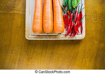 Fresh vegetables on chopping wood board