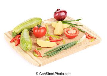 Fresh vegetables on cutting board.