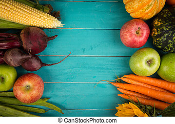 Farm fresh organic vegetables on rustic wooden blue table background