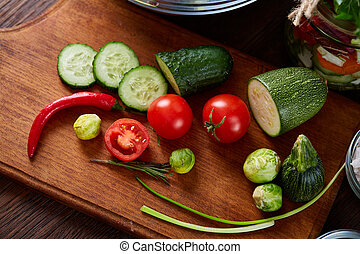 fresh vegetables on the cutting board over wooden background, selective focus, shallow depth of field