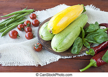 fresh vegetables on the table, zucchini and tomatoes