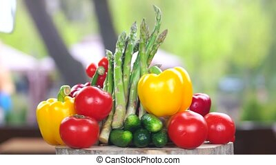 Fresh vegetables on wooden board. Bell peppers, tomatoes and...