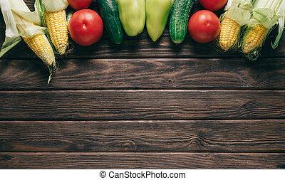 Fresh vegetables on wooden table.