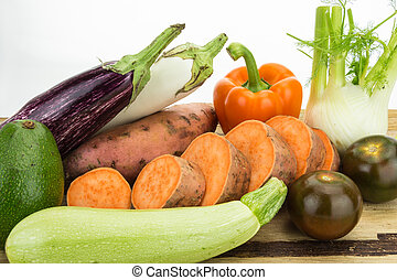 Fresh vegetables on wooden table with white background