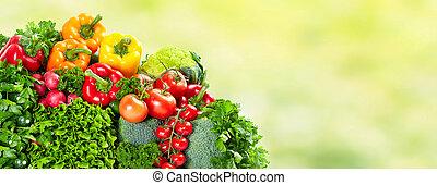 Vegetables over green background. - Fresh Vegetables over...