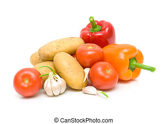 fresh vegetables. potatoes, tomatoes, peppers and garlic on a white background close-up. horizontal photo.