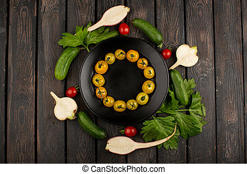 fresh vegetables ripe yellow tomatoes and other colorful vegetables on a wooden background