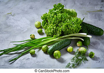 Fresh vegetables still life over white textured background, close-up, flat lay.