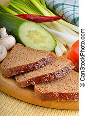 Fresh vegetables with bread