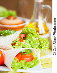 fresh vegetables wrapped in Armenian lavash, closeup