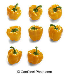 Fresh vegetables yellow sweet peppers isolated on white background