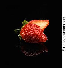 strawberry - fresh vivid colored strawberry over black...