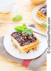 fresh waffles with sweet chocolate