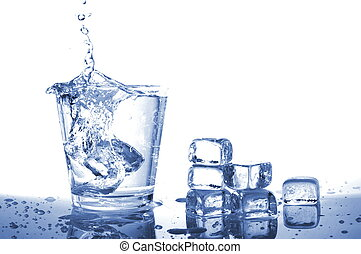 water in glass - fresh water in glass with ice cubes