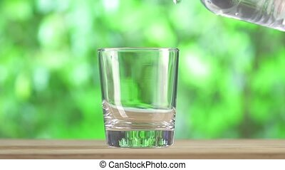 Fresh water pouring from plastic water bottle.