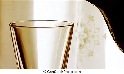 fresh water pouring in a glass, backlight