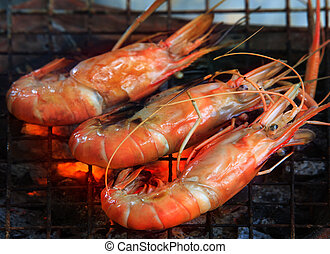 fresh water shrimp grilled on fire