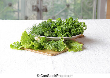 fresh watercress and dill in a bowl