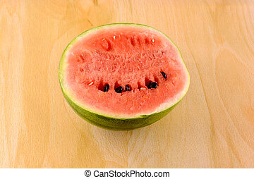 fresh watermelon fruit on wooden background