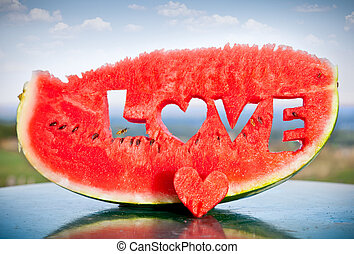 Fresh watermelon slice with love letters word - Fresh juicy...