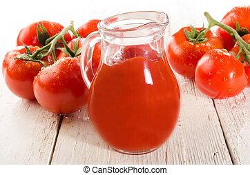 fresh wet tomato on white wood and tomato juice