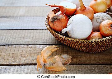 Fresh white and brown onions in a basket