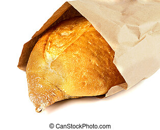 fresh white bread in a paper bag
