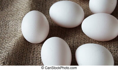 fresh white large raw eggs