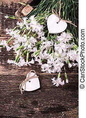 white spring flowers on wooden background .