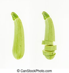 Fresh whole and sliced zucchini , isolated on white background