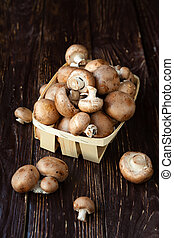 Fresh whole button mushrooms in a basket