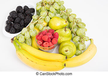 Raspberries Blackberries Grapes Bananas and Pears on White