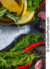 Fresh whole sea fish with aromatic herbs and spices