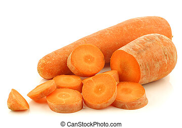 fresh winter carrot and a cut one