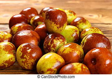 fresh winter jujube on a wood background