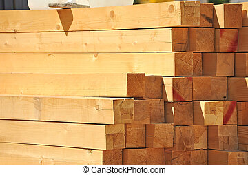 Fresh wooden beam, stacked at construction site
