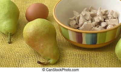 Fresh yeast. Fresh organic pears on yellow sacking.