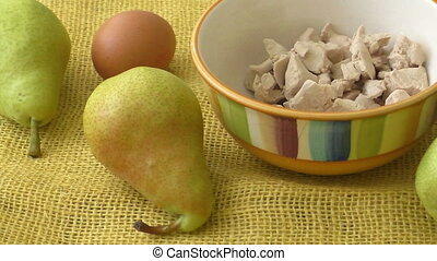 Fresh yeast. Fresh organic pears on yellow sacking.
