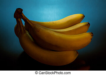 Fresh Yellow Bananas on Blue Background