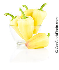 Fresh Yellow bell peppers in Glass bowl isolated on a white background