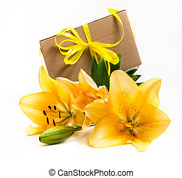 Fresh yellow lily with a gift box
